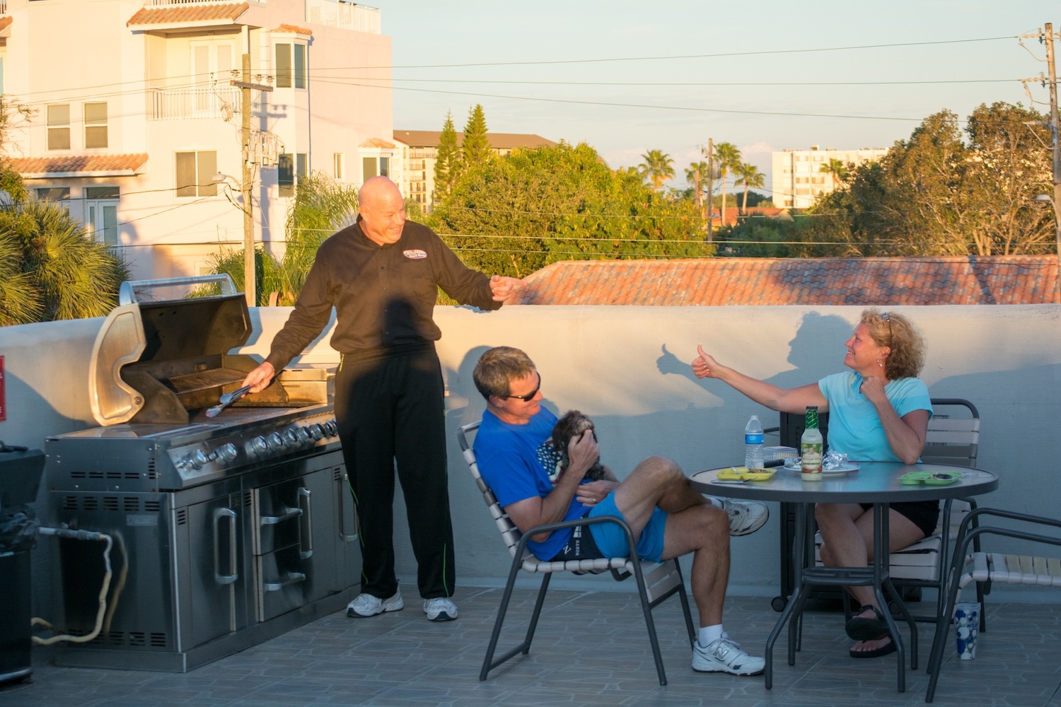 Camelot Beach Suites Pet Friendly Guests on Sun Deck with Dog