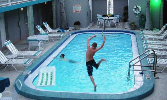 Camelot Beach Suites kid jumping in pool